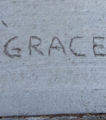 """I was walking in Cambridge, Massachusetts looking for tangible,concrete signs of grace during spring, 2013. I saw this on Berkeley Street: a literal concrete sign of grace! Typically people write """"love"""" or """"peace"""" in concrete. Here the person wrote """"grace."""""""